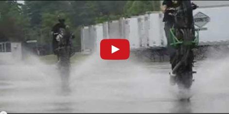 Stunt Bikes wheelie through puddles!